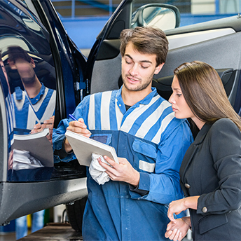 Car mechanic in Brisbane showing certificates